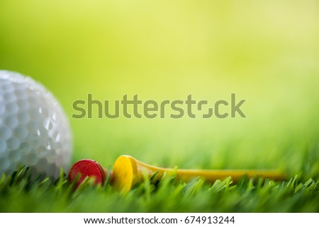 golf ball and tee on fairway