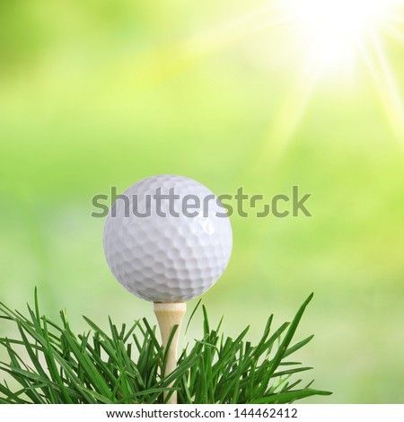 Golf Ball at Dawn in Green Long Grass isolated on white