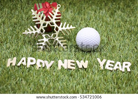 golf ball for merry christmas and happy new year theme on green grass golf course background