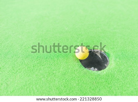 golf ball getting in the hole. concept about sport,goals and success