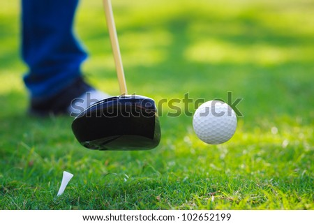 Golf ball hit off the tee with driver on golf course - stock photo