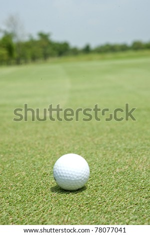 golf ball hole on a field