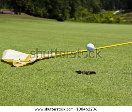 Golf ball in flight...hole in one