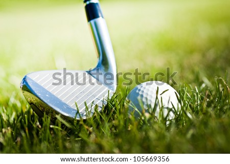 golf ball in grass and golf club - stock photo