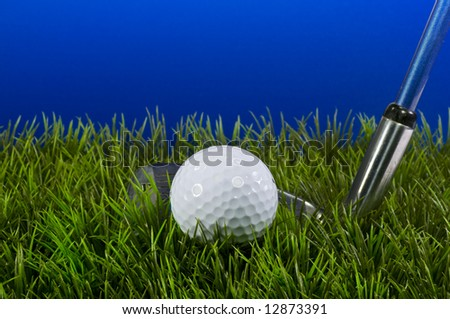 Golf ball in rough with blue background