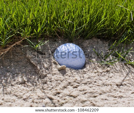 Golf ball in the sand