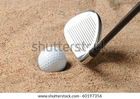 Golf Ball in Trap with Sand Wedge about to strike the Golfball. Close up in horizontal composition with copy space. - stock photo