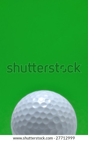 Golf Ball isolated on a green background, copy space, vertical
