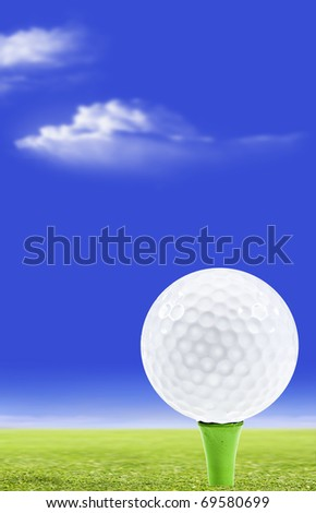 Golf ball on a green peg with golf course and sky in the background