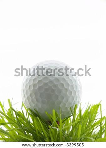 Golf ball on a tee in grass