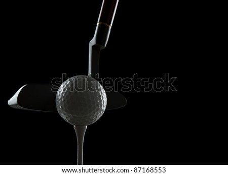Golf ball on black background with copy space