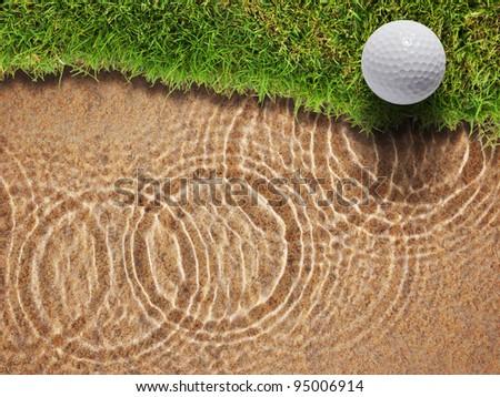 Golf ball on fresh green grass near water bunker in golf course - stock photo