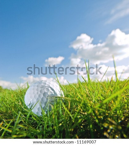 golf ball on grass of bunker with sky background