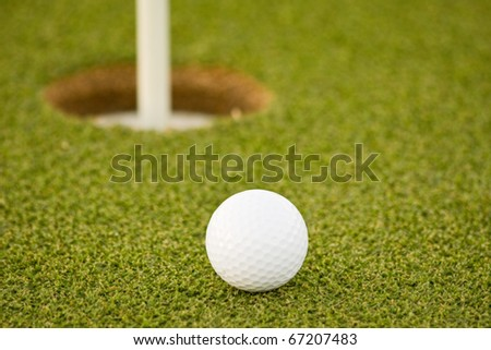 Golf ball on green with copy space
