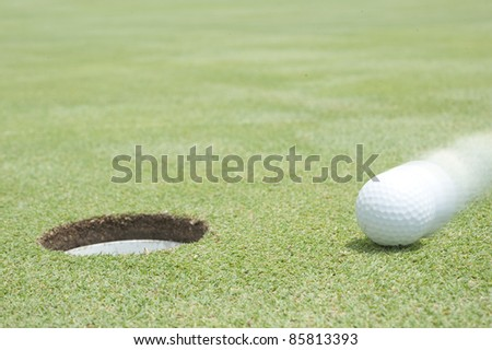 golf ball on lip of cup