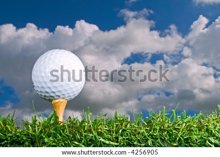 golf ball on tee from low angle