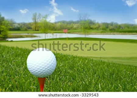 stock photo : golf ball on tee golf course background