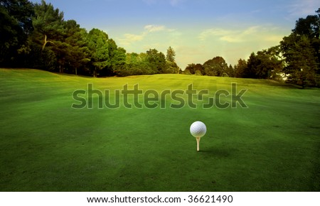 golf ball on tee in a beautiful golf club - stock photo