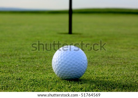 golf ball on tee in a golf club