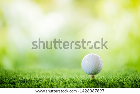 golf ball on tee to tee off