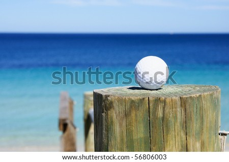 golf ball on the background of the ocean on the column