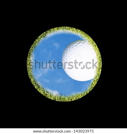 golf ball on the edge of a golf hole seen from below