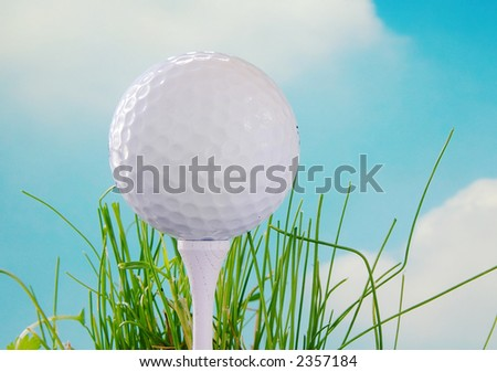 Golf ball on the tee and blue sky background