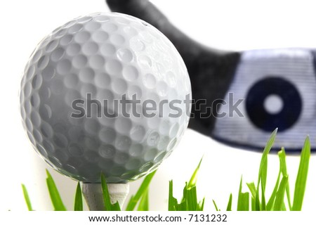 Golf ball on the tee, with driver