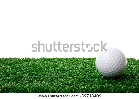 Golf ball ower green grass