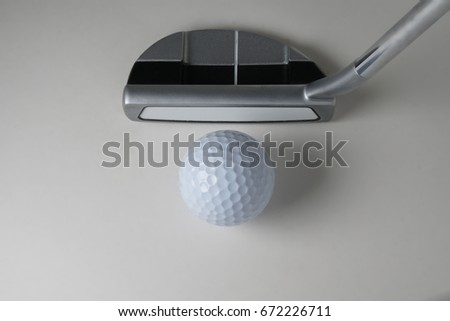Golf ball putter on a white back ground