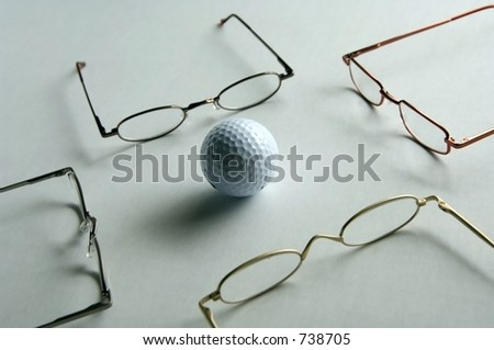 Golf ball surrounded by reading glasses