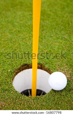 Golf ball very close to going in the hole