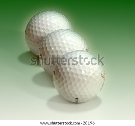 Golf balls on a green background.