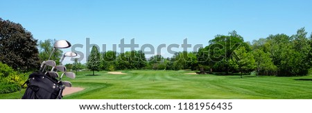 Golf Banner: A Golf bag with clubs on a par three tee box. Blue Sky and room for copy.