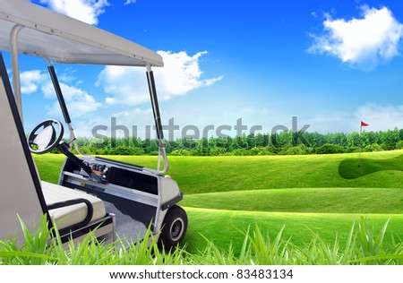 Golf car or cart and putting green next to hole