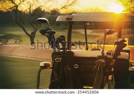 Golf cart - beautiful sunset overlooking gold course
