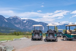 Golf carts on a golf course.