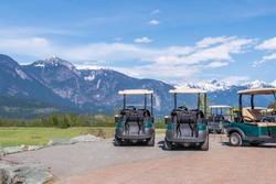 Golf carts on a golf course.