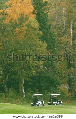 golf carts on the course in early autumn - stock photo