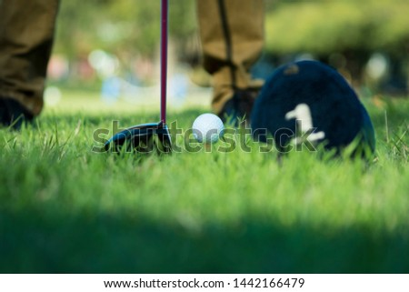 Golf club and ball on tee ready to shoot
