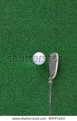 golf club and ball on the artificial turf,Looking down at the Angle