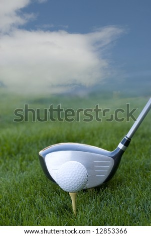 golf club and golf ball on green grass with blue sky