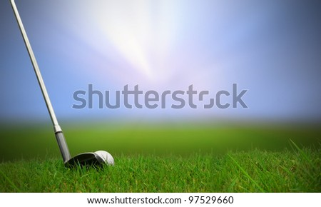 golf club hitting golf ball along fairway towards green with copy space