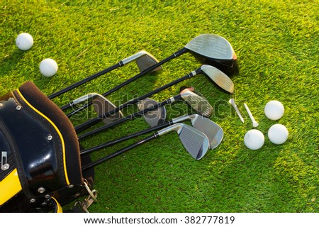 Golf club in bag on grass #382777819