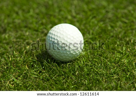 Golf club view of Golf ball in the putting green - sport