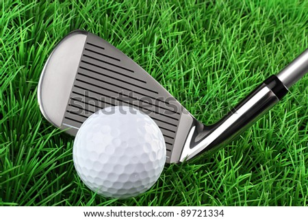 golf club with ball  on green