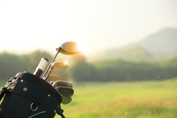 Golf clubs drivers over beautiful golf course at the sunset, sunrise time. , morning time