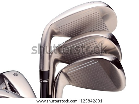 Golf clubs. Irons 6,7,8,9 and putting wedge on white background.