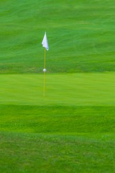Golf Course, golf green with flag in the hole, white flag