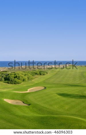 Golf course green grass, sea ocean and summer blue sky